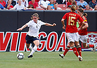 22 MAY 2010:  USA's Heather O'Reilly #9 and Germany's Sonja Fuss #15 during the International Friendly soccer match between Germany WNT vs USA WNT at Cleveland Browns Stadium in Cleveland, Ohio. USA defeated Germany 4-0 on May 22, 2010.