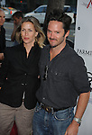 "BEVERLY HILLS, CA. - July 27: Director Scott Cooper (R) and Jocelyne Cooper arrive at AFI Associates & Sony Pictures Classics' premiere of ""Get Low"" held at the Samuel Goldwyn Theater inside The Academy of Motion Picture Arts and Sciences on July 27, 2010 in Beverly Hills, California."