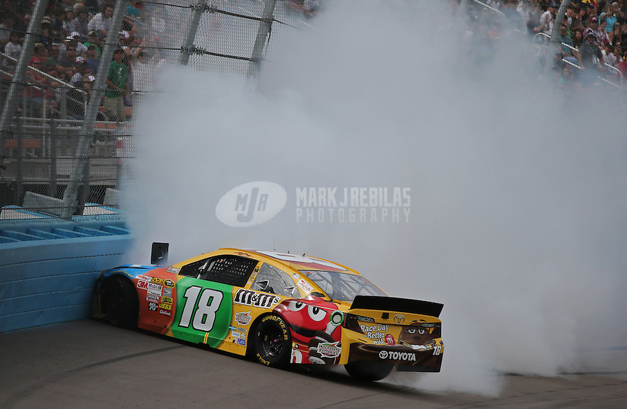 Mar. 3, 2013; Avondale, AZ, USA; NASCAR Sprint Cup Series driver Kyle Busch spins during the Subway Fresh Fit 500 at Phoenix International Raceway. Mandatory Credit: Mark J. Rebilas-