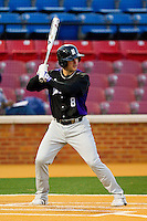 Nick Linne #8 of the Northwestern Wildcats at bat against the Wake Forest Demon Deacons at Gene Hooks Field on February 26, 2011 in Winston-Salem, North Carolina.  Photo by Brian Westerholt / Four Seam Images