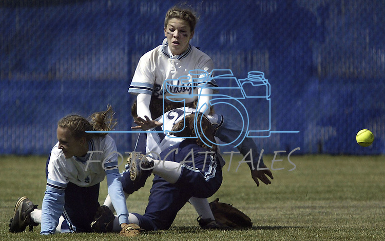 Centennial players, from left, left fielder Stefanie Lentz, shortstop (12) Karissa Fernandez and center fielder Erica Dresel collide on a blooper into shallow left during the NIAA 2004 State Softball Championship at Carson High on Saturday.  Centennial defeated Douglas High 13-2 and 5-4 to win the title..Photo by Cathleen Allison