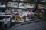 Men play cards in Rocinha, the biggest favela in Brazil, with over 100,000 residents, in Rio de Janeiro, Br., on Thursday, Jan. 24, 2013. About 3,000 police officers and soldiers moved into one of the largest slums in Latin America early November 2011 in an effort by the Brazilian government to assert control over lawless areas of the city ahead of the 2014 World Cup and 2016 Summer Olympics.