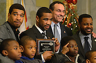 December 22, 2011  (Washington, DC)  IBF/WBA Junior Welterweight Champion Lamont Peterson (center, left) poses for a photo with DC Council Chairman Kwame Brown (right), his brother Anthony Peterson (left) and local children after he was given the key to the city by District of Columbia Mayor Vincent Gray (center, right).  Peterson won the Title with his win over Amir Khan at the DC Convention Center on December 10, 2011.  Anthony also won his fight on the same night.  (Photo by Don Baxter/Media Images International)
