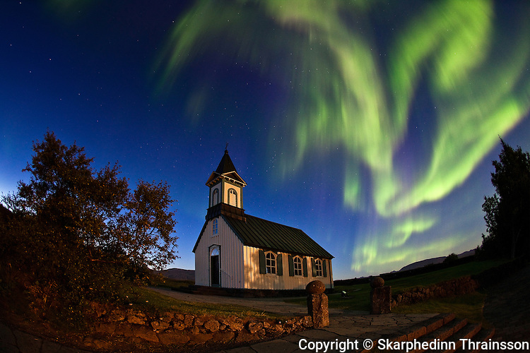 Aorora Borealis over the church in Þingvellir National Park, south-west Iceland