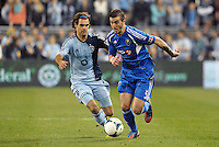 Jeb Brovsky (5) Montreal defender goes past Graham Zusi (8) Kansas City..Sporting Kansas City defeated Montreal Impact 2-0 at Sporting Park, Kansas City, Kansas.