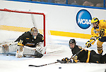 March 26,  2011                     Michigan forward Derek DeBlois (18, right) reaches over Colorado defenseman Gabe Guentzel (A) (10) for the puck after he knocked him down in the third period.  At left is Colorado goalie Joe Howe (31). The University of Michigan defeated Colorado College 2-1 in the championship game of the NCAA Division 1 Men's West Regional Hockey Tournament, on Saturday March 26, 2011 at the Scottrade Center in downtown St. Louis.