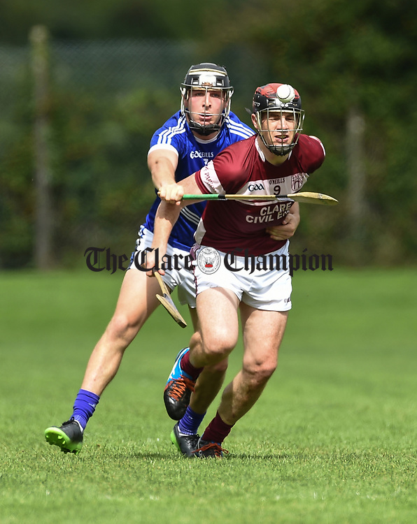 Shane Gleeson of Cratloe in action against Kevin Dilleen of St Joseph's Doora Barefield during their round three senior championship game in Sixmilebridge. Photograph by John Kelly