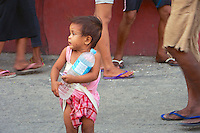 Boy holding a water bottle, Cebu, Philippines