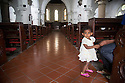 Sri Lanka selection<br /> Baby girl with pink shoes in church in Galle<br /> <br /> Picture by Gavin Rodgers/ Pixel8000<br />  07917221968