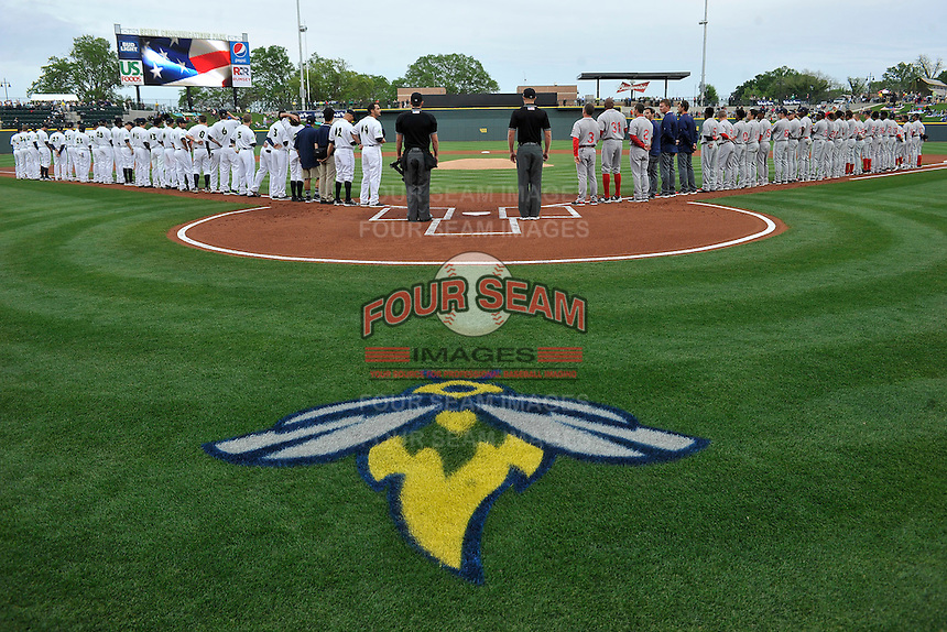 The Columbia Fireflies and Greenville Drive are lined up for the National Anthem on Thursday, April 14, 2016, the team's first day at the new Spirit Communications Park in Columbia, South Carolina. The Mets affiliate moved to Columbia this year from Savannah. Columbia won, 4-1. (Tom Priddy/Four Seam Images)