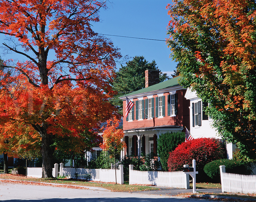 Homes and fall foliage along a residential street in Amherst, New Hampshire.