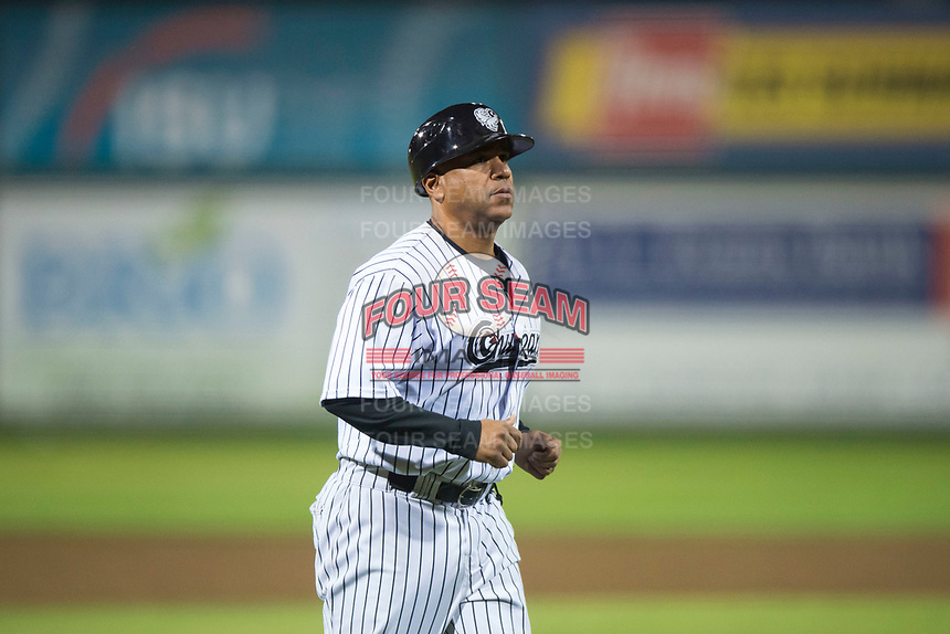 Idaho Falls Chukars manager Omar Ramirez (11) walks off the field between innings of a Pioneer League game against the Billings Mustangs at Melaleuca Field on August 22, 2018 in Idaho Falls, Idaho. The Idaho Falls Chukars defeated the Billings Mustangs by a score of 5-3. (Zachary Lucy/Four Seam Images)