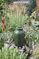 An urn and a spray of autumn flowering ornamental grass can be a dramatic  pairing as Dan Johnson  shows here in his Denver garden.