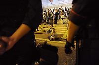 Roma, 12 Ottobre 2011.Indignati presidiano e si accampano in via Nazionale nei pressi di palazzo Koch sede di Bankitalia. Dopo la mezzanotte vengono sgomberati dalle forze dell'ordine resistendo in modo passivo