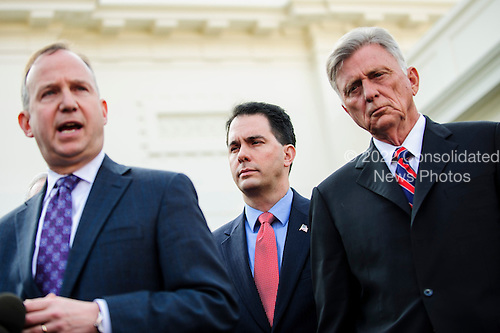 A bipartisan delegation of governors speak to the media outside of the White House in Washington, District of Columbia, U.S., on Tuesday, Dec. 4, 2012, after meeting with President Barack Obama and Vice President Joe Biden meet discuss the actions needed to keep our economy growing and find a balanced approach to reduce our deficit. Pictured (l-r) Jack Markell (D-DE), Scott Walker (R-WI) and Mike Beebe (D-AR)..Credit: Pete Marovich / Pool via CNP