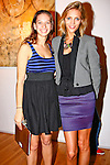 Polina Raygorodskaya, event organizer and President of Polina Fashion poses with event hostess, model Anja Rubik. Photographed during Yoga for Wii video game launch, 463 West Street, Ramscale Loft, November 9 2009., event organizer and President of Polina Fashion poses with event hostess, model Anja Rubik. Photographed during Yoga for Wii video game launch, 463 West Street, Ramscale Loft, November 9 2009. Half body.
