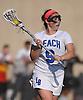 Caitlin Breglia #9 of Long Beach carries behind the net during the Nassau County varsity girls lacrosse Class B quarterfinals against North Shore at Long Beach High School on Thursday, May 19, 2016. She scored the game-winner in overtime to lead Long Beach to a 9-8 victory.