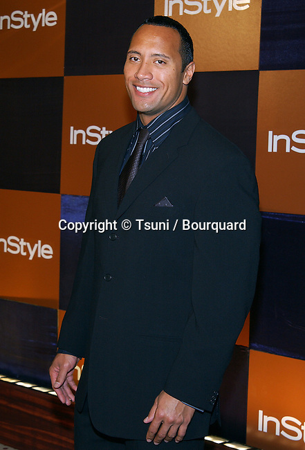 """Dwayne Johnson - The Rock - arriving at the Golden Globes Awards,""""In Style After Party""""  at the Beverly Hilton Hotel in Los Angeles. January 19, 2003          -            JohnsonDwayne_TheRock013.jpg"""