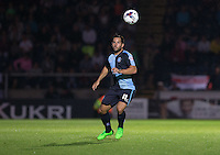 Sam Wood of Wycombe Wanderers keeps eyes on the ball during the Capital One Cup match between Wycombe Wanderers and Fulham at Adams Park, High Wycombe, England on 11 August 2015. Photo by Andy Rowland.