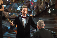 Matthew McConaughey presents the Oscar&reg; for achievement in film editing to Lee Smith for work on &ldquo;Dunkirk&rdquo; during the live ABC Telecast of The 90th Oscars&reg; at the Dolby&reg; Theatre in Hollywood, CA on Sunday, March 4, 2018.<br /> *Editorial Use Only*<br /> CAP/PLF/AMPAS<br /> Supplied by Capital Pictures