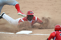 Batavia Muckdogs outfielder K.J. Woods (13) slides into third during the first game of a doubleheader against the Williamsport Crosscutters on July 29, 2014 at Dwyer Stadium in Batavia, New York.  Williamsport defeated Batavia 3-2.  (Mike Janes/Four Seam Images)