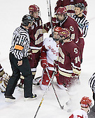 Mike Brennan 4, Anthony Aiello 2 and Matt Greene 14 of Boston College surround Blake Geoffrion 16 of the University of Wisconsin. The Boston College Eagles defeated the University of Wisconsin Badgers 3-0 on Friday, October 27, 2006, at the Kohl Center in Madison, Wisconsin in their first meeting since the 2006 Frozen Four Final which Wisconsin won 2-1 to take the national championship.<br />