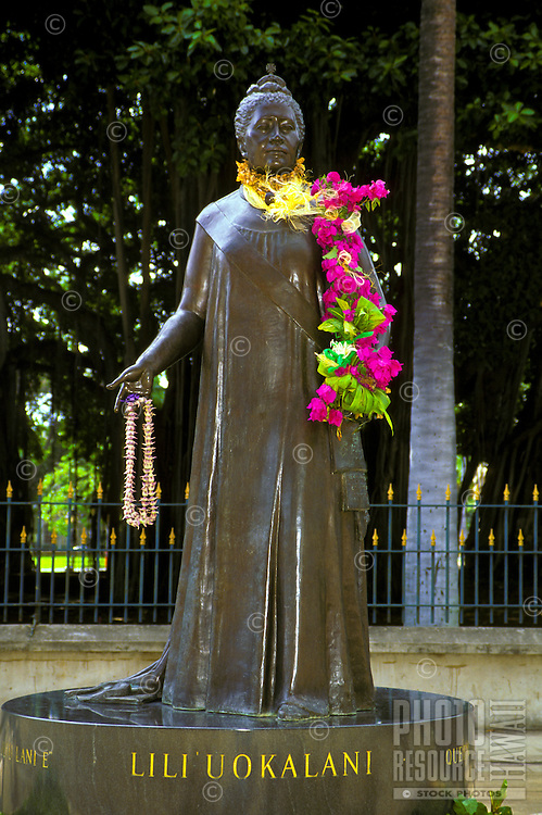 Statue of Queen Liliuokalani wearing flower lei over shoulder; Hawaii State Capitol grounds, Honolulu, Oahu