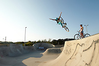 Clinton Johns riding DMR jump bike , with girlfriend Georgina watching .  Hayle skatepark, Cornwall .