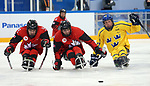 Pyeongchang, Korea, 10/3/2018-James Dunn, Corbyn Smith of Canada plays Sweden in hockey during the 2018 Paralympic Games in PyeongChang. Photo Scott Grant/Canadian Paralympic Committee.