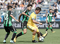 Calcio, Serie A: Reggio Emilia, Mapei stadium, 17 settembre 2017.<br /> Juventus' Paulo Dybala (r) in action with Sassuolo's Francesco Manganelli (c) and Stefano Sensi (l) during the Italian Serie A football match between Sassuolo and Juventus at Reggio Emilia's Mapei stadium, September 17, 2017.<br /> UPDATE IMAGES PRESS/Isabella Bonotto