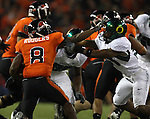OSU WR, 8 James Rodgers, gives a stiff arm to an Oregon player during the Civil War at Reser Stadium in Corvallis, November 29, 2008.