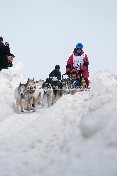 2010 Iditarod Ceremonial Start in Anchorage Alaska musher # 65 BRUCE LINTON with Iditarider TOM McGARRITY