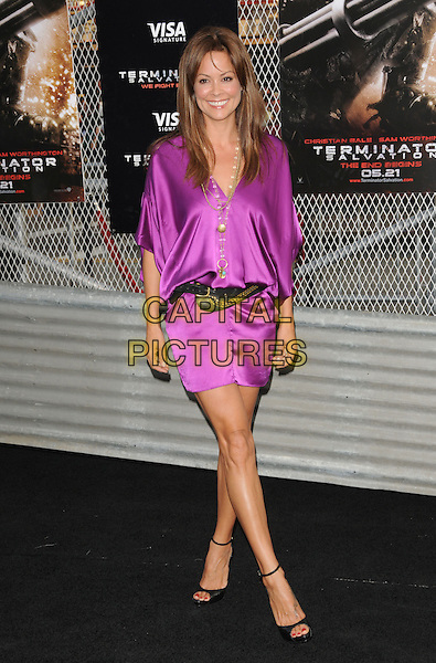 "BROOKE BURKE.The Warner Brothers Pictures U.S. Premiere of ""Terminator Salvation"" held at The Grauman's Chinese Theatre in Hollywood, California, USA. .May 14th, 2009.full length purple silk satin dress necklaces belt open toe shoes .CAP/DVS.©Debbie VanStory/Capital Pictures."