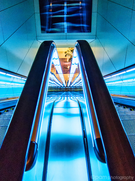Blue abstract of lines created by two escalators at night