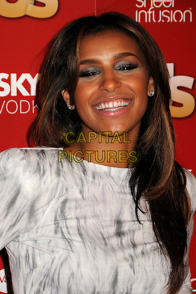 MELODY THORNTON.At US Weekly's Hot Hollywood Party 2009 held at Voyeur, West Hollywood, California, USA, .18th November 2009..portrait headshot white grey gray print pattern smiling .CAP/ADM/BP.©Byron Purvis/AdMedia/Capital Pictures.