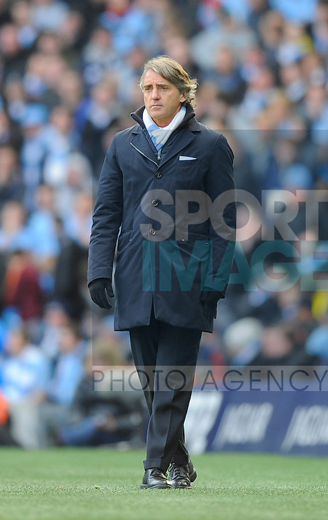 Roberto Mancini manager of Manchester City.Barclays Premier League.Manchester City v Tottenham at the Eithad Stadium, Manchester 22nd January, 2012..Sportimage +44 7980659747.picturedesk@sportimage.co.uk.http://www.sportimage.co.uk/.Editorial use only. Maximum 45 images during a match. No video emulation or promotion as 'live'. No use in games, competitions, merchandise, betting or single club/player services. No use with unofficial audio, video, data, fixtures or club/league logos.