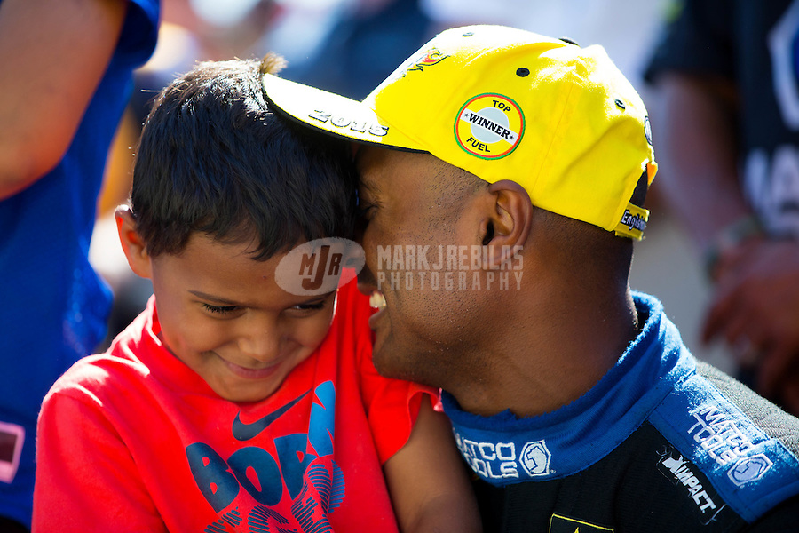Jun 7, 2015; Englishtown, NJ, USA; NHRA top fuel driver Antron Brown (right) celebrates with son Adler Brown after winning the Summernationals at Old Bridge Township Raceway Park. Mandatory Credit: Mark J. Rebilas-