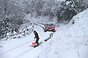 "21/01/15<br /> <br /> With a backdrop to one of the best views in the Derbyshire Peak District, Hilary Stephens single-handedly spends two hours digging 500 yards of tracks and spreading grit on them to help her car make it up the hill at Monsal Head. She needed to clear the one-in-five hill so she could get out to feed her horse. She said: ""I chose a bad day to have my four-by-four serviced! But you've got to carry on if you have animals""<br /> <br /> All Rights Reserved - F Stop Press.  www.fstoppress.com. Tel: +44 (0)1335 300098"