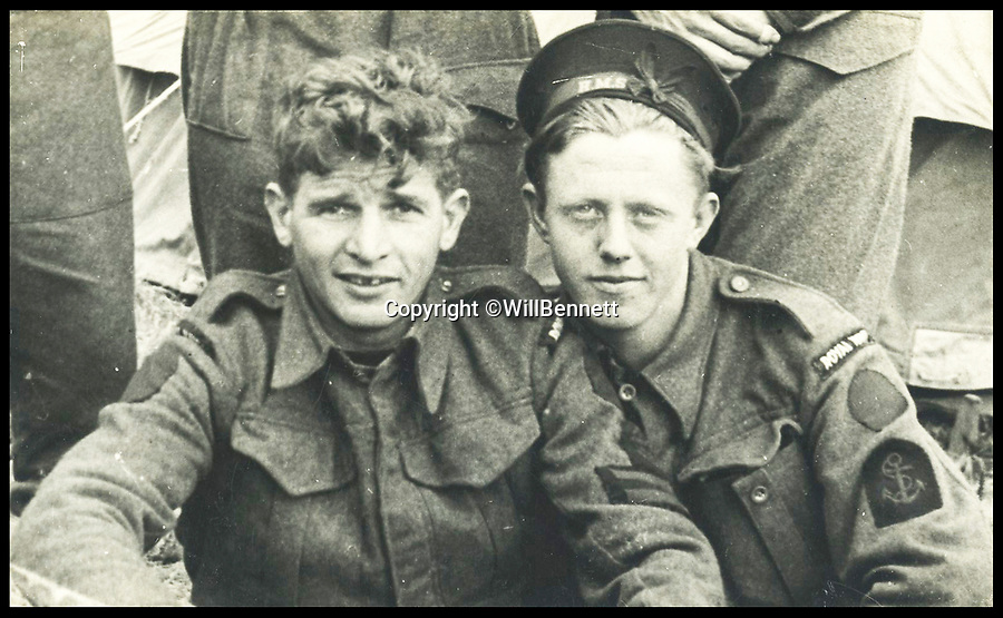 BNPS.co.uk (01202 558833)Pic: WillBennett/BNPS<br /> <br /> The medals of heroic Petty Officer Ronald McKinlay (pictured right) are being auctioned.<br /> <br /> The incredible heroics of a navy commando who single-handedly took out two huge German guns on D-Day can be told after his prestigious gallantry medals were put up for auction.<br /> <br /> Petty Officer Ronald McKinlay was nominated to destroy one of the 88mm guns which he did by sneaking up close enough to hurl three hand grenades at it before taking the only surviving German prisoner.<br /> <br /> Later on that day, he braved sniper fire to drag to safety a wounded colleague lying face down in the dirt.<br /> <br /> After the war McKinlay became a Royal Navy frogman under the legendary 'Buster' Crabb and was a consultant for the John Mills film Above Us the Waves.