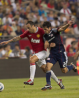 Manchester United FC forward Dimitar Berbatov (9) on the attack as New England Revolution midfielder Benny Feilhaber (22) defends. In a Herbalife World Football Challenge 2011 friendly match, Manchester United FC defeated the New England Revolution, 4-1, at Gillette Stadium on July 13, 2011.