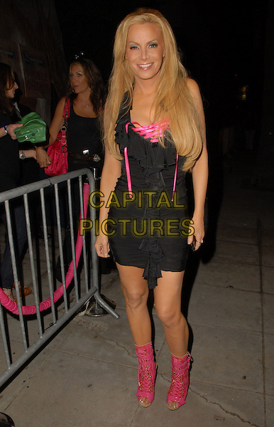 CINDY MARGOLIS .At the Launch Party for the T-Mobile Sidekick LX Tony Hawk Edition held at a private location, Hollywood, California, USA, 01 August 2008..full length black dress ruffle pink boots lace up shoes .CAP/ADM/FS.©Faye Sadou/Admedia/Capital Pictures