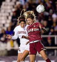 Alina Garciamendez (4) of Stanford goes up for a header against Kristen Mewis (19) of Boston College during the second game of the NCAA Women's College Cup at WakeMed Soccer Park in Cary, NC.  Stanford defeated Boston College, 2-0.