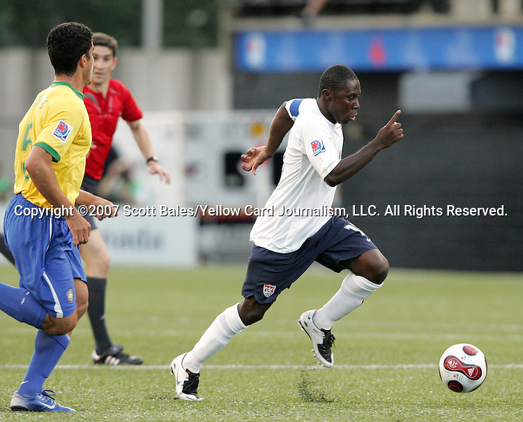 06 July 2007: USA's Freddy Adu (right) dribbles away from Brazil's Roberto (5). The Under-20 Men's National Team of the United States defeated Brazil's Under-20 Men's National Team 2-1 in a Group D opening round match at Frank Clair Stadium in Ottawa, Ontario, Canada during the FIFA U-20 World Cup Canada 2007 tournament.