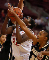 Ohio State Buckeyes center Darryce Moore (22) is fouled by Purdue Boilermakers guard Dee Dee Williams (20) in the second half of a women's basketball game between the Ohio State Buckeyes and the Purdue Boilermakers at Value City Arena on January 2, 2014. ( Dispatch photo by Fred Squillante)