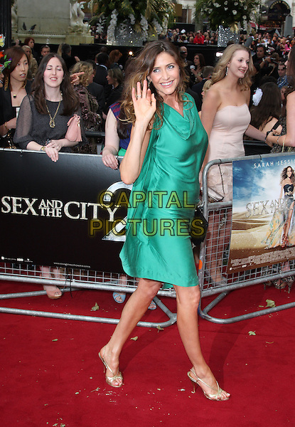 LISA SNOWDON.Arrivals to the 'Sex And The City 2' European Premiere at the Odeon, Leicester Square, London .May 27th, 2010.full length green silk dress hand waving  side clutch bag one shoulder sleeve gold strappy sandals.CAP/ROS.©Steve Ross/Capital Pictures.