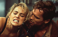 Total Recall (1990) <br /> Arnold Schwarzenegger &amp; Sharon Stone<br /> *Filmstill - Editorial Use Only*<br /> CAP/KFS<br /> Image supplied by Capital Pictures