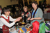 Saint Thomas the Apostle had an arts and crafts Holiday Bazaar Sunday afternoon.<br /> <br /> 9748 &ndash; Kathaleen Hayes and Elaine Barba purchased various items from Helene Delmas.