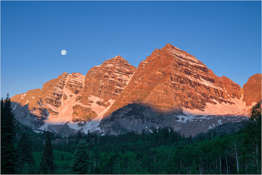I arrived at the Maroon Bells well before sunrise in order to photograph the night sky over the mountains and Crater Lake. After capturing those images of iconic Colorado, I moved up the valley towards Crater Lake. As first light was illuminating the two 14ers, the full moon was hanging just above the Bells. I had to pause to capture this rare landscape image of the most photographed mountains in Colorado.