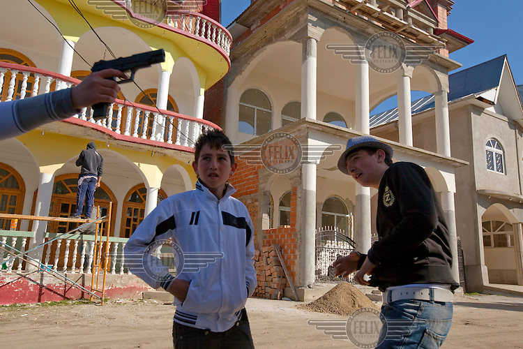 Children play on the streets of Buzescu. Buzescu is known for it's ultra-wealthy Roma and their bizarre mansions that line the main street. The Roma of Buzescu are part of the Kalderash clan and are known for being coppersmiths and dealing with metal scraps. After the fall of the communist regime in the late 80's, they stripped old factories of their metals and some made a small fortune re-selling them. They are also known for making cazane, copper stills that produce alcohol such as palinka, a plum brandy.