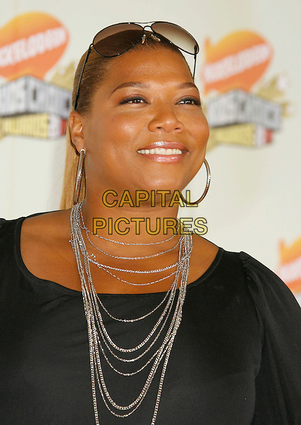 QUEEN LATIFAH.20th Annual Nickelodeon Kids' Choice Awards held at UCLA's Pauley Pavilion, Westwood, California, USA,.31 March 2007..portrait headshot suglasses on head silver necklace.CAP/ADM/RE.©Russ Elliot/AdMedia/Capital Pictures.